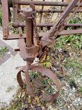 Rusted farm equipment gears royalty free stock photo