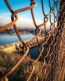 Rusted fence in focus stock photography