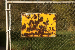 Rusted Fence Sign. Yellow rusted fence sign Stock Photos