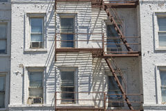 Rusted Fire ladder on abandoned building in New York Stock Images