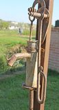 Rusted fountain with the lever to pump water Stock Photography