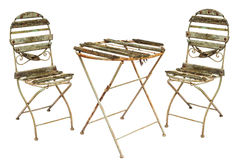 Rusted garden chairs and table isolated on white Stock Photo