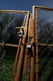 Rusted garden gate. With damaged wire-netting Royalty Free Stock Image