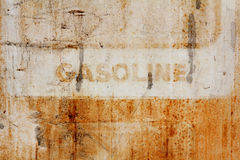 Rusted gasoline sign. The front of an antique gasoline pump with rust and scratch textures royalty free stock photo