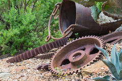 Rusted gears in nature. Old rusted vintage gears with other metals in nature Stock Photography