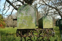 Rusted green mail boxes. Royalty Free Stock Image