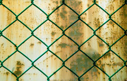 Rusted Green Wire Fence over Grunge Metal Background Royalty Free Stock Image