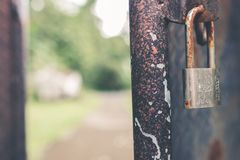 Rusted Grey Padlock in Selective-focus Photography Stock Image