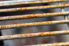 Rusted Grill Bars Horizontal. Rusted metal grill bars pictured horizontally showing signs of deterioration Royalty Free Stock Photos
