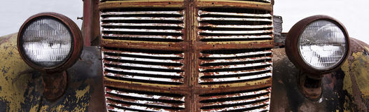 Rusted Grill of Vintage Car. With headlights Royalty Free Stock Photo