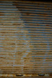Rusted grunge corrugated metal door background Royalty Free Stock Photos