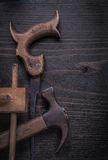 Rusted hand saw vintage marking gauge claw hammer Stock Images