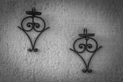 Rusted hanging pot stands Black and White royalty free stock photo