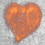 Rusted heart. On a wall in the background Royalty Free Stock Image