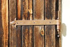 Rusted Hinge on Wooden Door Stock Photo