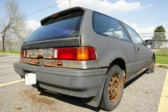Rusted Honda Car. Picture of the rusted honda car in the parking royalty free stock photo