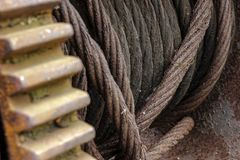 Rusted iron cable on a giant industrial spool stock photo