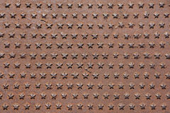 Rusted iron cast panel covered with five-pointed stars pattern. Royalty Free Stock Photography