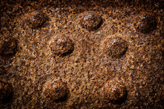 Rusted Iron 1. A close up of an old rusted riveted iron plate. A great texture image for a background or overlay stock photography