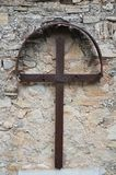 Rusted Iron Cross. Very old iron cross on a wall in Norcia. Picture taken May 2014 Stock Photos