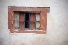 Rusted iron grids. Rusted iron bars in a old windows from a wall Stock Photos