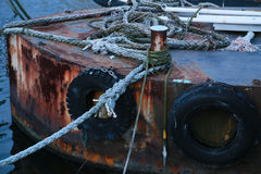 Rusted iron ship. Scene of a rusted iron ship while anchored by a rope Royalty Free Stock Photos