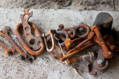 Rusted iron tools. Rusted iron objects used and placed on the cement Royalty Free Stock Image