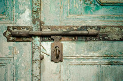 Rusted keyhole on green wooden door Royalty Free Stock Images
