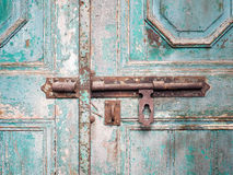 Rusted keyhole on wooden door Stock Photos