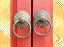 Rusted knocker of red door Royalty Free Stock Image