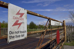Rusted level crossing by railway line. Wirral, England Royalty Free Stock Images