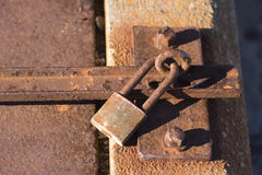 Rusted Lock. A rusted lock holds a door shut Royalty Free Stock Image