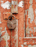 Rusted Lock. On wooden door royalty free stock photo