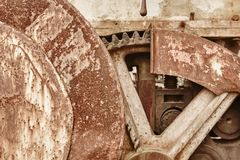 Rusted machinery detail in warm tone. Grunge Stock Photography