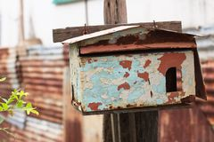 Rusted Mailbox. Rusted old mailbox not in use, but is still placed at front of the house entrance stock image