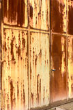 Rusted main door. Main entrance of abandoned industry - rusty door of iron plate Royalty Free Stock Photography