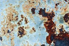 Rusted Metal. Closeup of peeling blue paint on rusted metal surface royalty free stock images
