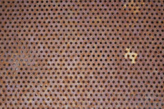 Rusted Metal Background. Rusted orange and brown metal screen background stock images