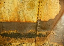 Rusted Metal Background with Rivet Holes and Seams Royalty Free Stock Photos