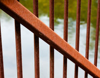 Rusted metal beam diagonal across smaller bars. Royalty Free Stock Photography