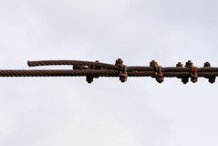 Rusted metal cables fastened together Stock Photo