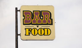 Rusted Metal Faded Sign Advertising Bar Food Stock Images