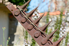 Rusted metal farm plough blades Royalty Free Stock Images