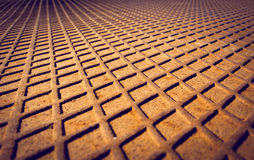 Rusted metal floor with a diamond-shaped pattern Royalty Free Stock Photography
