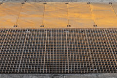 Rusted metal industrial pavement with lattice Royalty Free Stock Photo