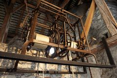 Rusted Metal Lift. Elevated mechanical lift with the rope and rusted gears exposed. Horizontal shot Royalty Free Stock Images
