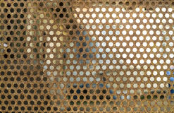 Rusted metal plate with round holes Stock Images