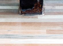 Rusted metal pole on the tiles floor. Royalty Free Stock Photo