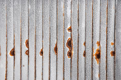 Rusted Metal Sheeting: Vertical. Abstract closeup of vertical metal sheeting with rusty surface details Royalty Free Stock Photo