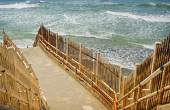 Rusted Metal Stairway to Ocean, California. A staircase with worn concrete and rusted handrails and protective fencing providing a barrier from the sea, climbs Royalty Free Stock Photos